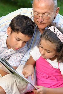 Bigstockphoto_Grandfather_And_Kids_Reading_B_5223438
